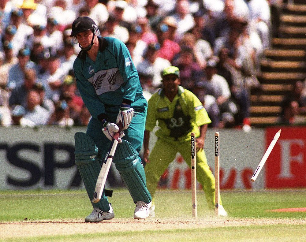 New Zealand's Matthew Horne is bowled by Pakistan's Abdul Razzaq in the World Cup semi-final at Old Trafford, June 1999