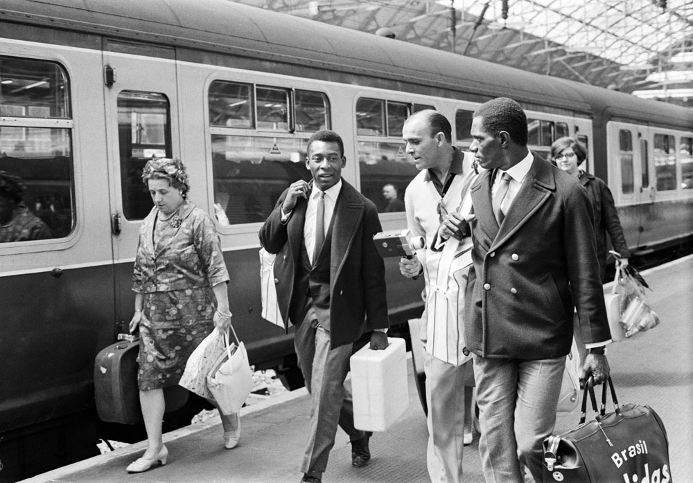 Pele, left, on the platform at Manchester's Piccadilly Station, July 1966