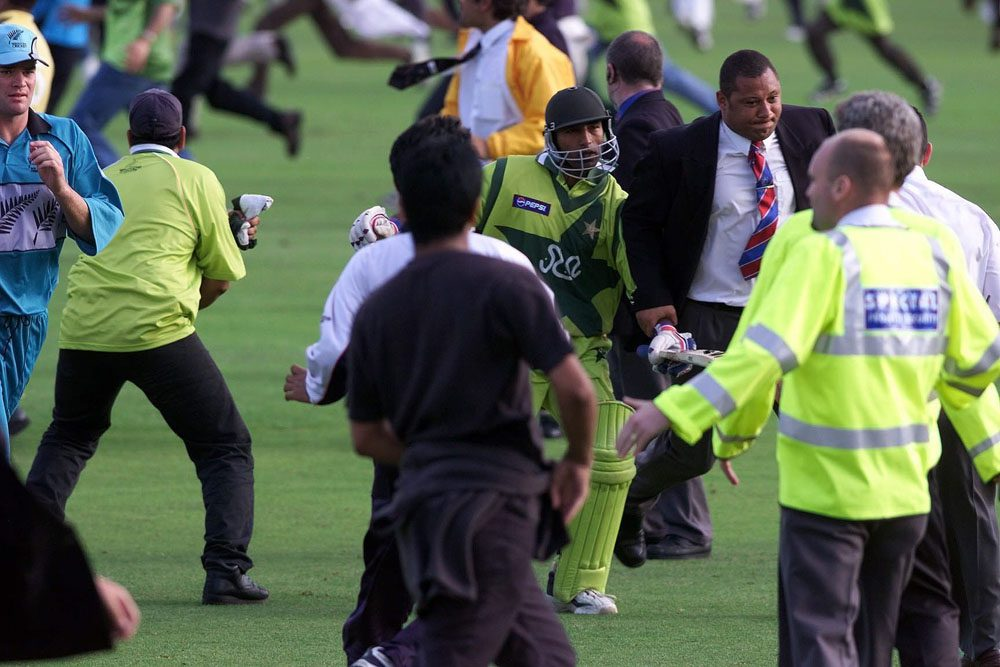 Saeed Amwar races off the pitch after victory against New Zealand in the World Cup semi-final at Old Trafford, June 1999