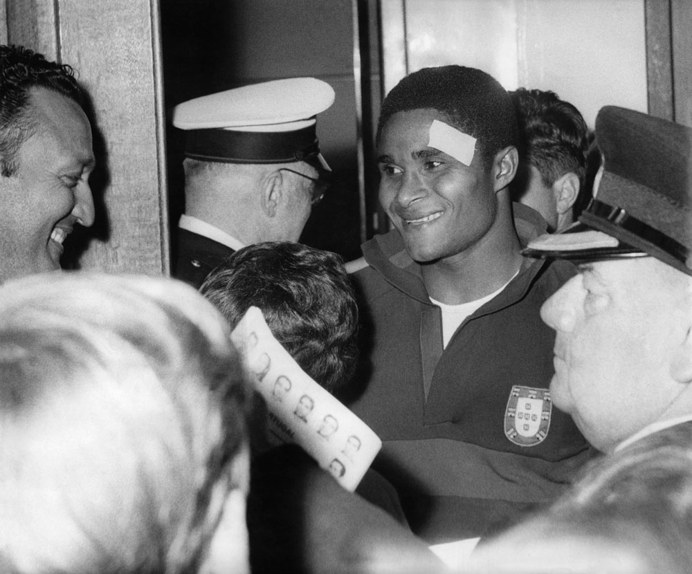 A happy Eusebio sports a plaster after Portugal's win against Hungary at Old Trafford