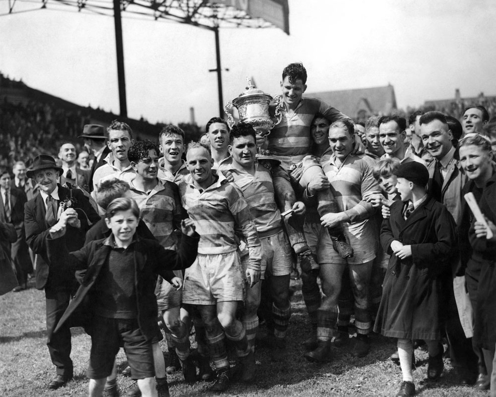 Rugby League Championship Final. Dewsbury v. Wigan at Maine road, Manchester. Egan the Wigan captain with the cup is carried in triumph by his cheering team mates after their victory over Dewsbury. June 1947