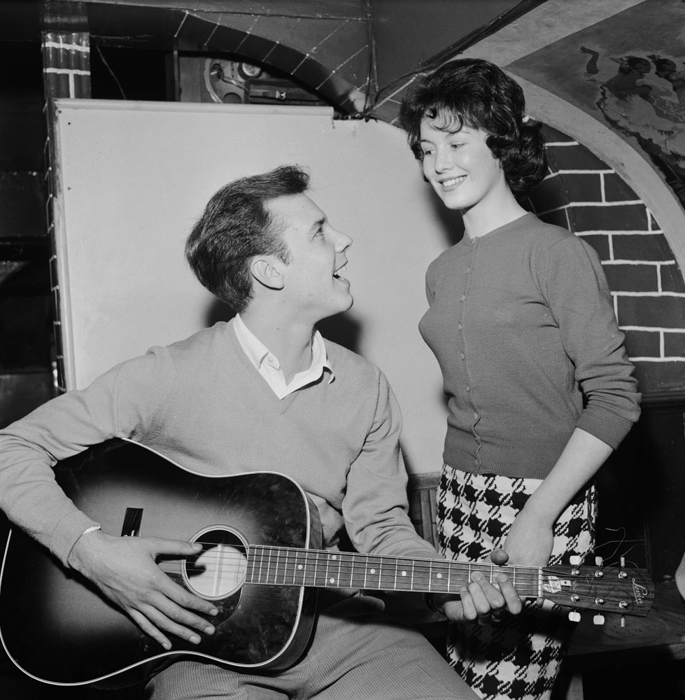 Marty Wilde sings to his fiancée, Vernons Girl Joyce Baker, October 1959