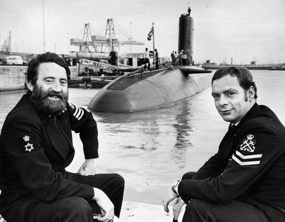 Petty Officers Alan Pugh, left, and John Young with HMS Conqueror at Seaforth docks, August 1979