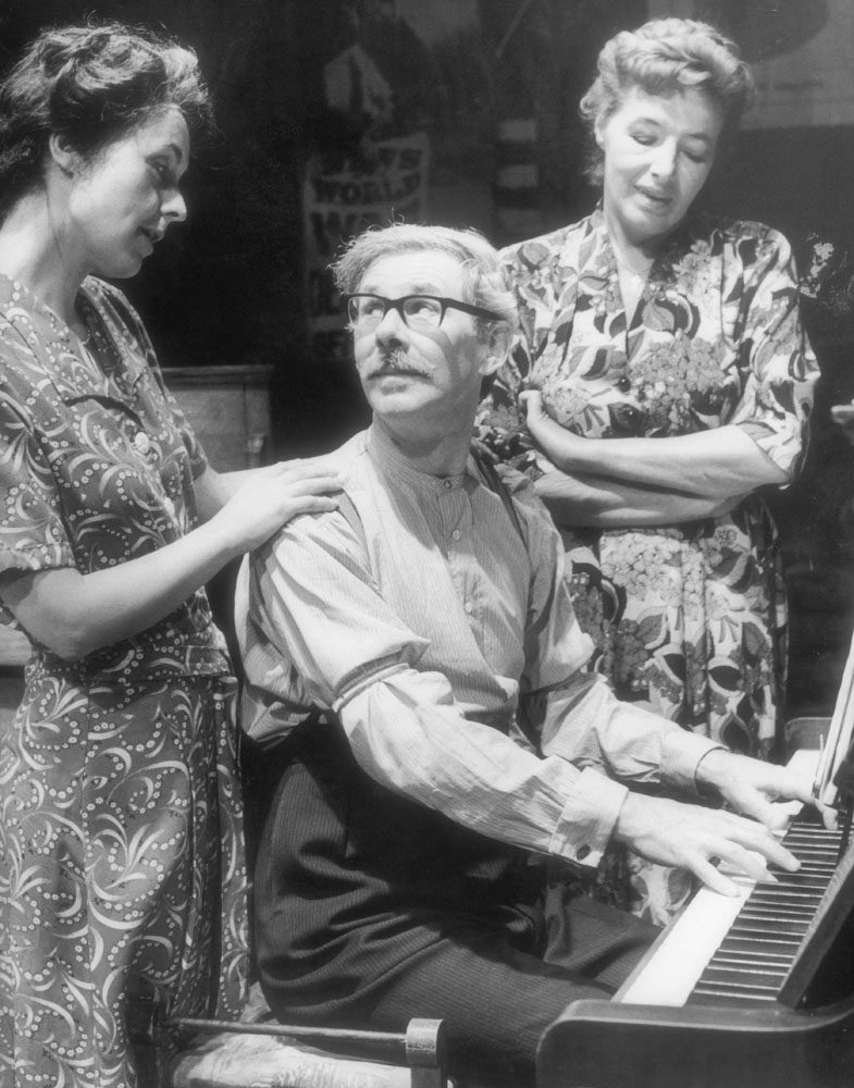 Stephen Hancock (Ernie Bishop) at the piano in C.P. Taylor's wartime story And a Nightingale Sang, May 1980