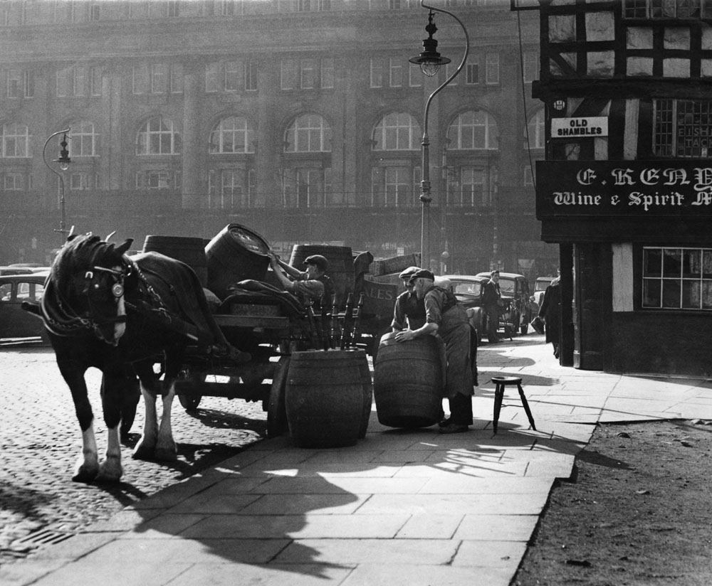 Beer is delivered by brewer's dray to the Old Shambles, October 1951