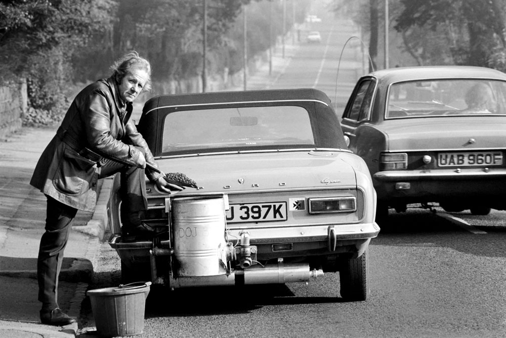 Douglas Purser shovels anthracite into his coal-powered Ford Capri 1.6, February 1975