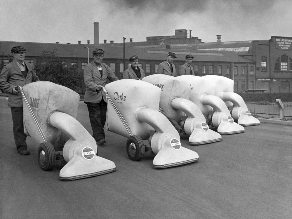 Salford street-cleaners line up with their new American super vacuums, October 1964