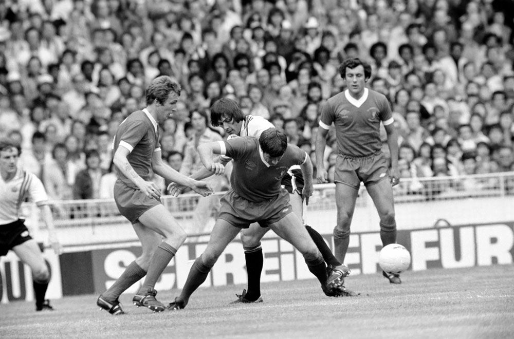 Emlyn Hughes battles for the ball as Liverpool take on United in the Charity Shield at Wembley, August 1977