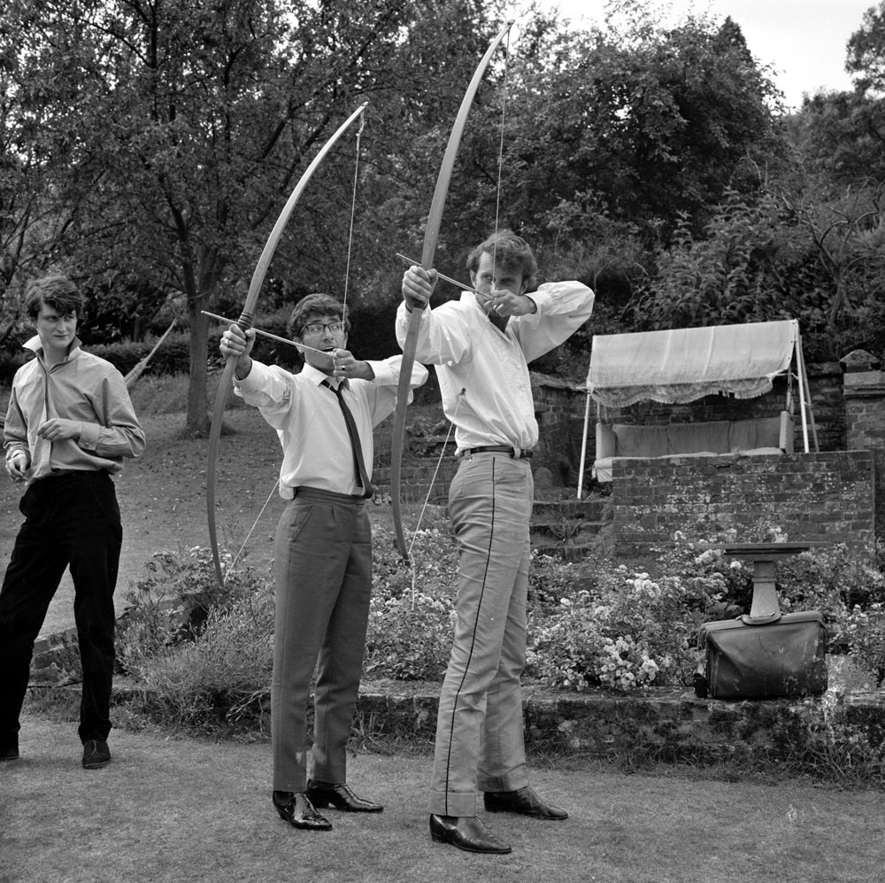 Lead-singer Freddie Garrity, centre, tries his hand at archery at Longleat, August 1965
