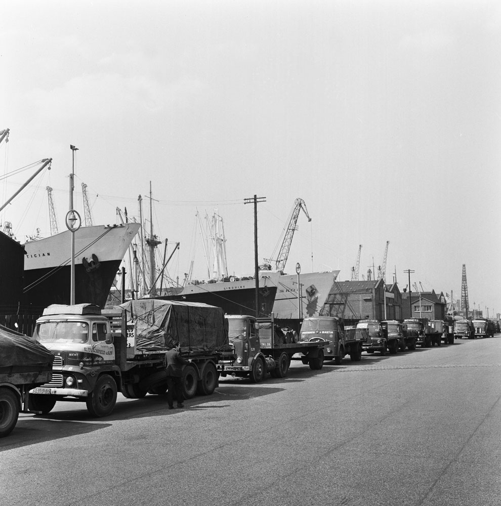 Lorries laden with exports queue up next to strike-bound ships at Liverpool Docks, May 1966