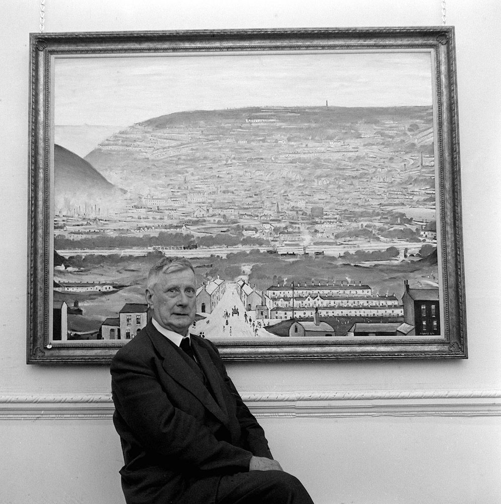 Artist L. S. Lowry in front of his work at the opening of his one-man exhibition, October 1961