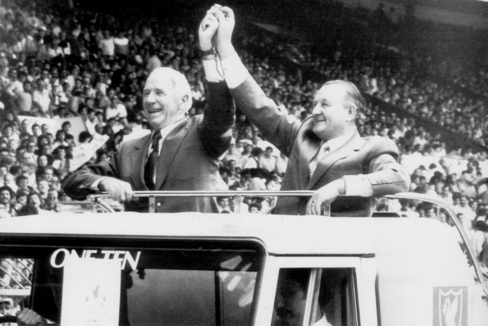 Two greats together: Sir Matt Busby and Bob Paisley salute the Wembley crowd at the 1983 Charity Shield match