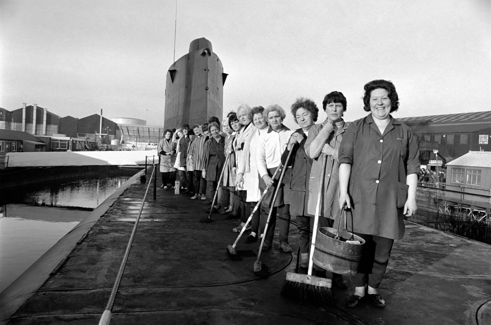 Cleaners proudly pose on the deck of HMS Revenge before her commissioning day, December 1969