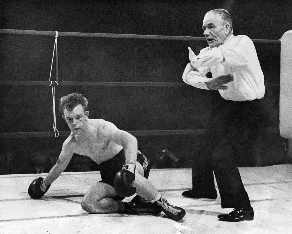 Tony Barlow takes a count during his fight against John McCluskey at the Free Trade Hall, January 1967