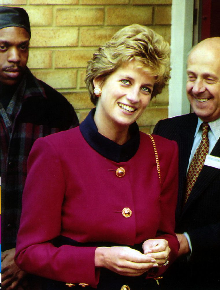 A smiling Princess Diana unveils the opening plaque at Hulme housing project, October 1993