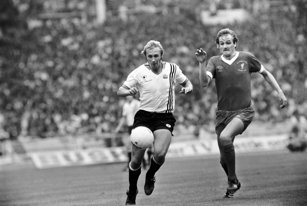 Liverpool's Phil Thompson challenges United's Brian Greenhoff during the 1977 Charity Shield match at Wembley