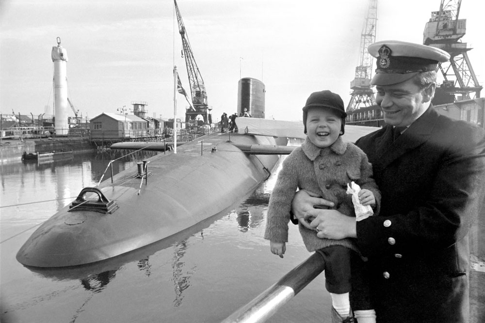 Young Andrew Parr and his proud Dad Chief Petty Officer Frank Parr with HMS Revenge on her commissioning day, December 1969