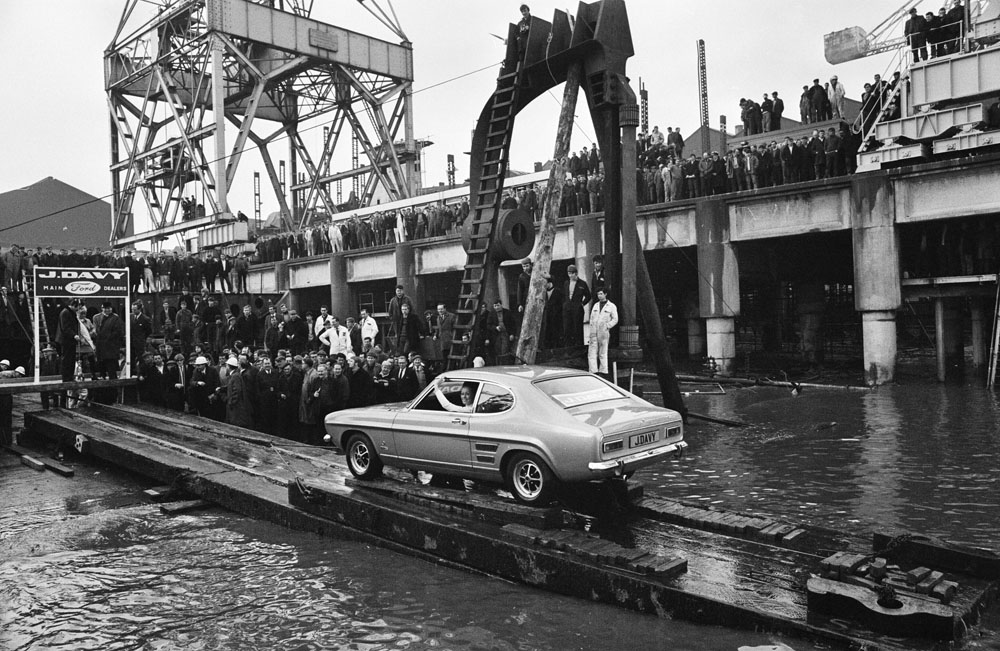 The newly launched Ford Capri rolls down the slipway at the Cammell Laird shipyards, February 1969