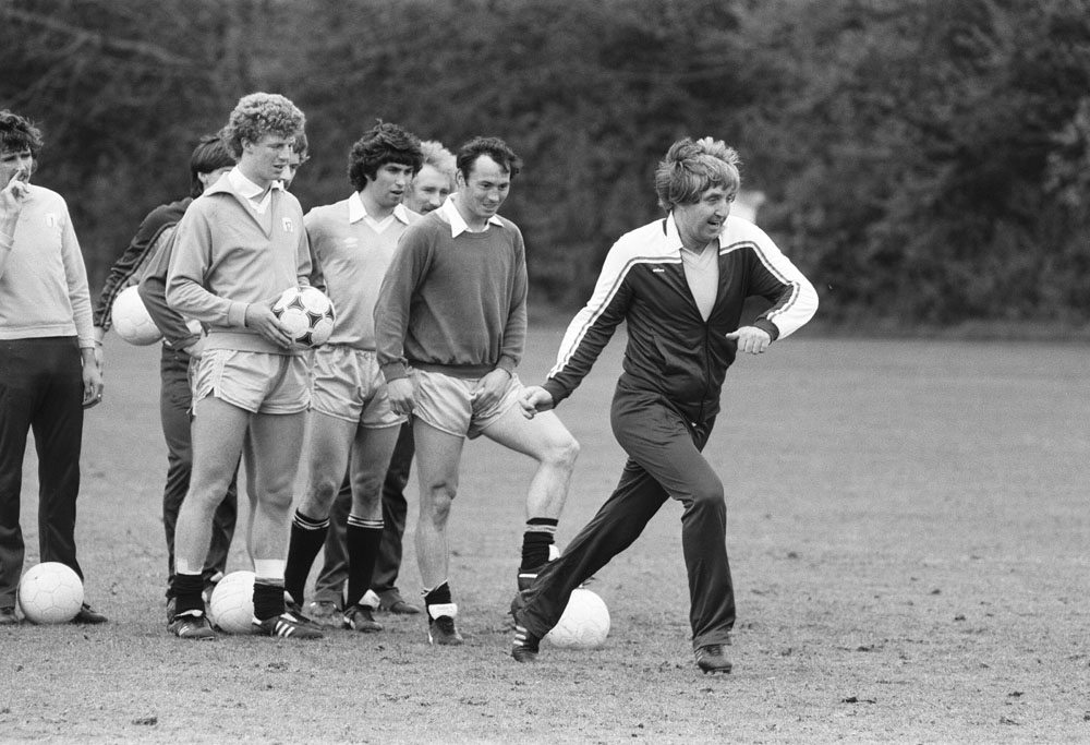 Manager John Bond leads City players on the training pitch, May 1981