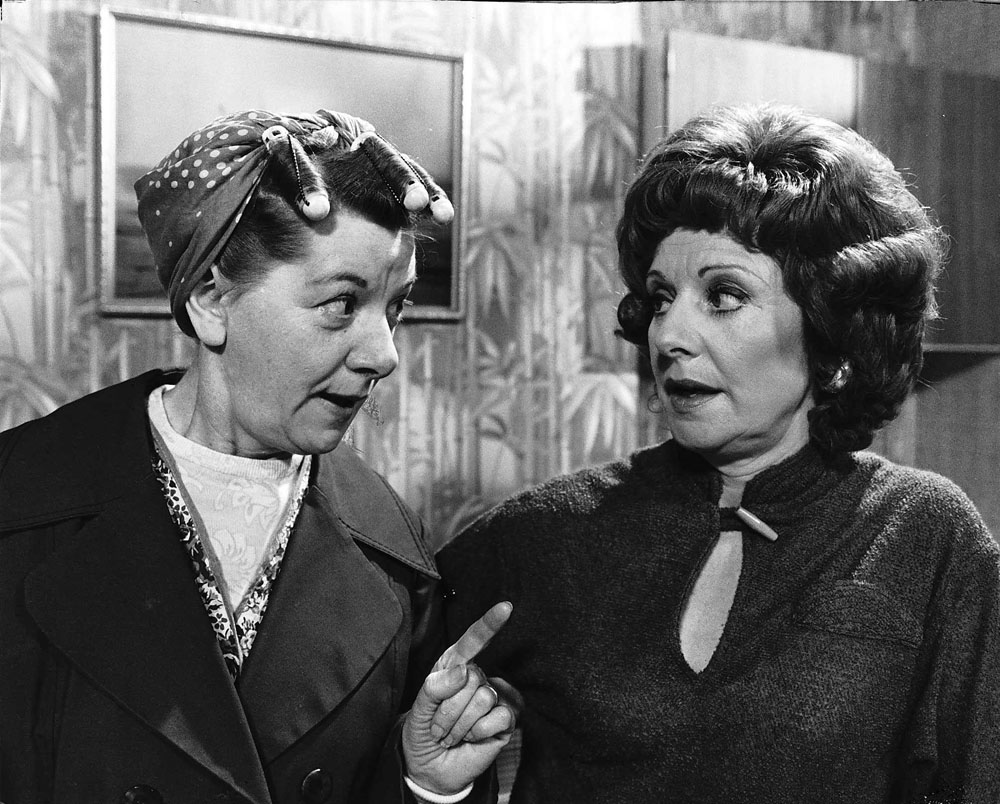 Oldham actress Barbara Knox (Rita Sullivan) gets a pointer from Jean Alexander (Hilda Ogden), January 1981