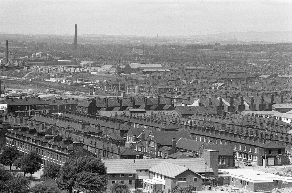 Rows of terraced houses are prominent in this aerial view of Salford, July 1974