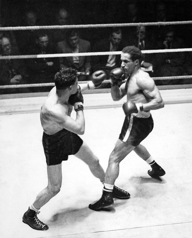 Alex Buxton, right, exchanging jabs with Italian Bernardo Pacini at the King's Hall, June 1952
