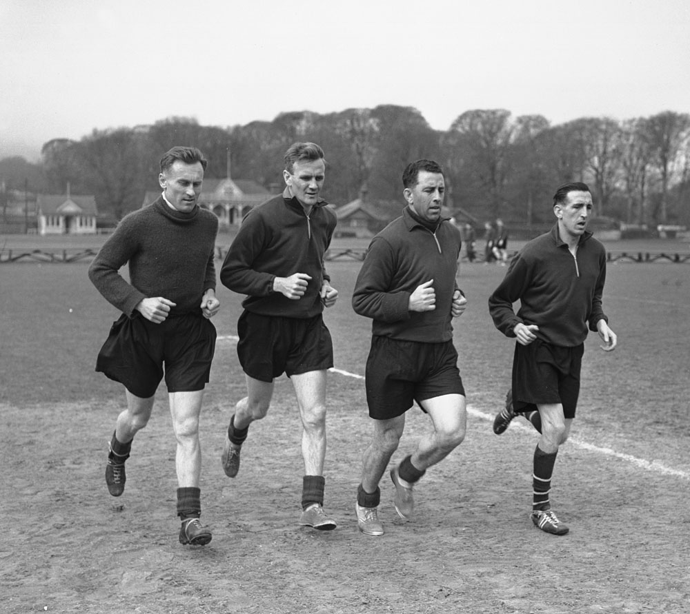 Don Revie, second left, leads the training for his City team-mates, May 1956