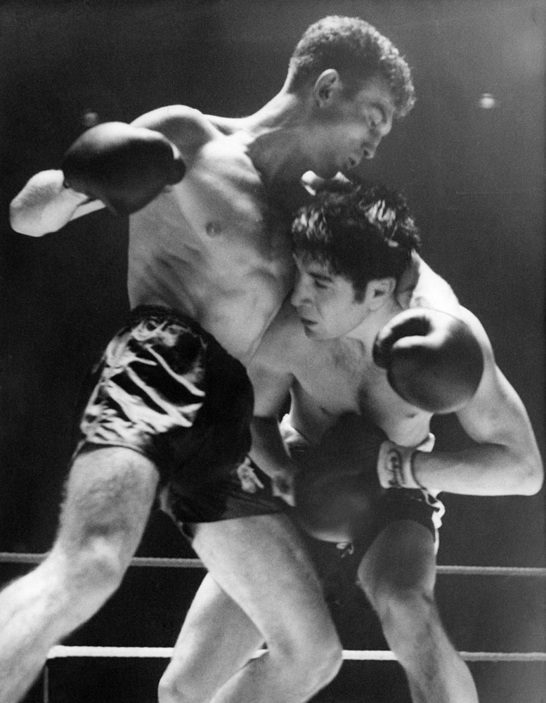 Bobby Ros and Willie Toweel in action during their lightweight bout at Belle Vue, September 1957