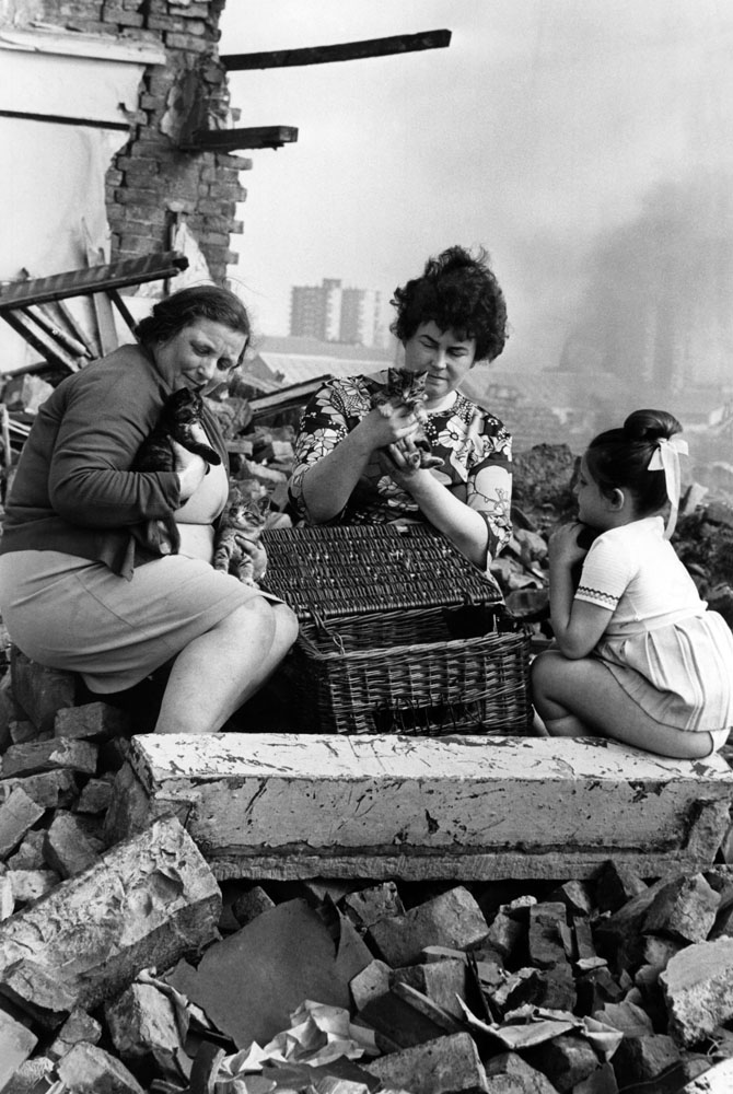 Dedicated Salford women Mrs Norma Parker, Mrs Diane Shepherd and her daughter Cristina (5) rescue kittens from demolition debris in Ordsall, July 1972
