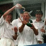 Shane Warne celebrates Australia's win July 1997 by spraying bottle of champagne over fellow players in Third Test at Old Trafford