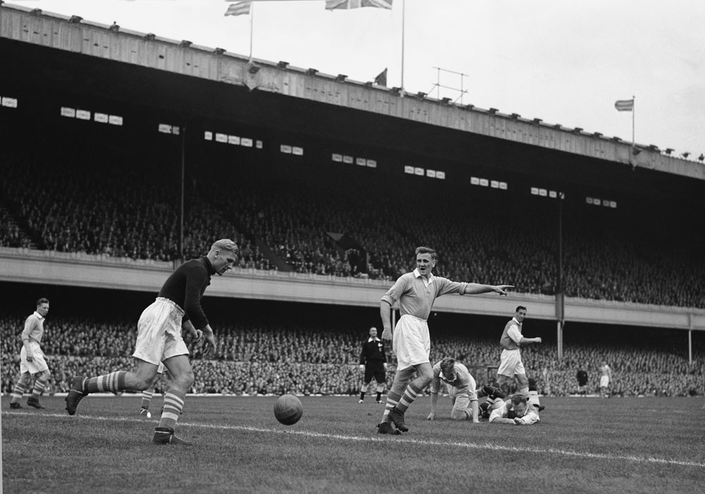 Centre-forward Don Revie points the way for 'keeper Bert Trautmann during City's 2-2 draw with Arsenal at Highbury, September 1953