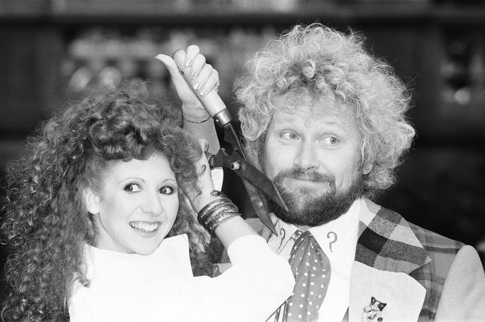 Bonnie Langford, who played Mel Bush, tries to cut Colin Baker's beard in a preview of the Doctor Who adventure The Trial of a Time Lord, October 1986