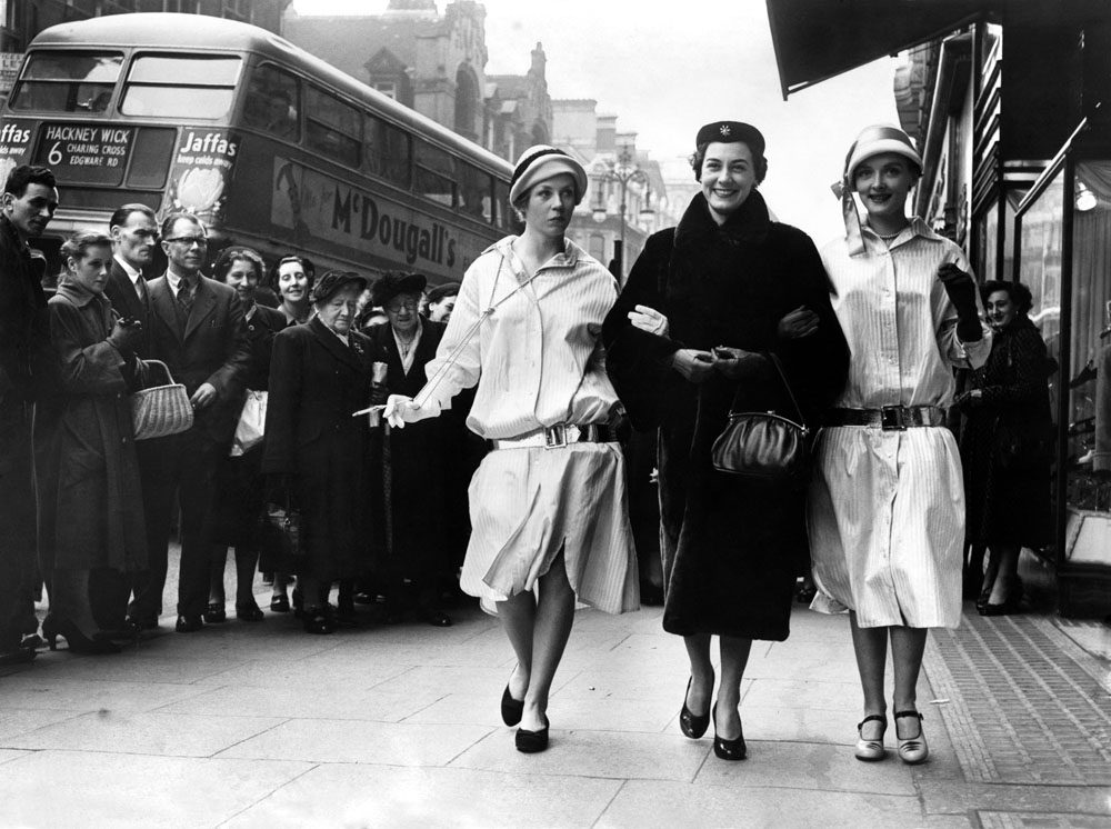 Stepping out: Liverpool Actress Anne Rogers, centre, and models Judy Simpson and Paula Young cause a stir in London's Oxford Street, March 1954