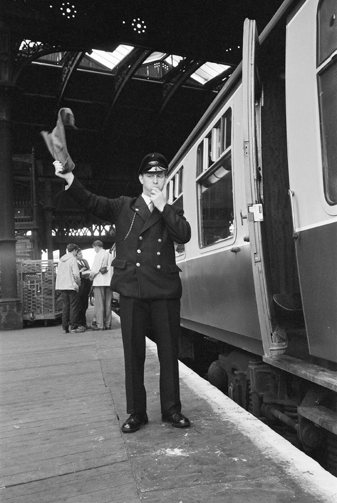 At 1106 on 11 August 1968, Henry Crossland blows for 1T57 to depart Manchester Victoria for Carlisle.