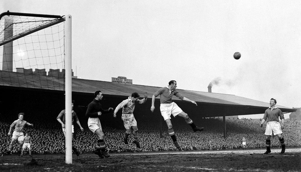 Bill Foulkes heads clear for United in their 5-0 league defeat by City at Old Trafford, February 1955