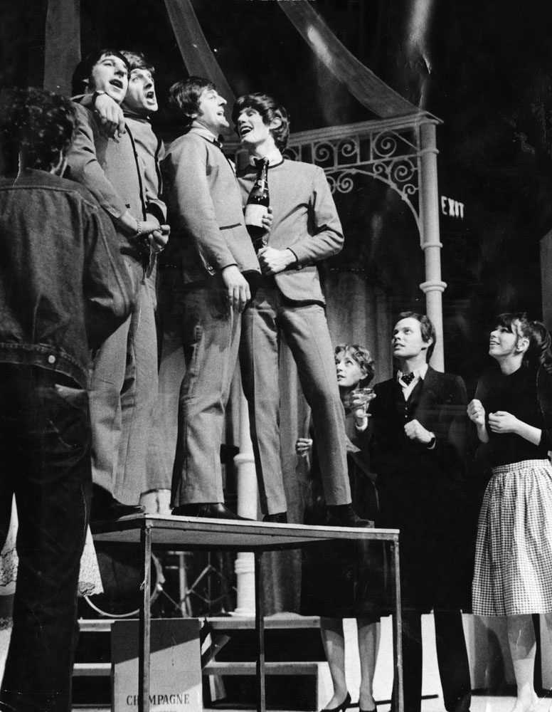 A scene from the musical John, Paul, George, Ringo and Bert with Brian Epstein, played by Robin Hooper, looking on from the side, May 1974