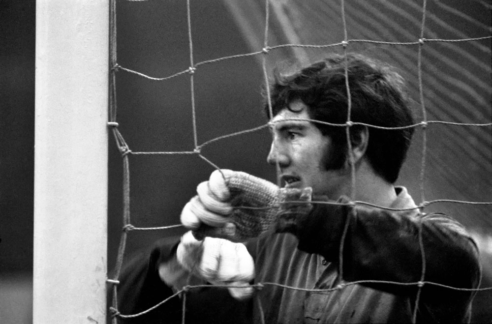 Joe Corrigan peeps through the net during City's 4-0 away win against West Ham on 6 December 1969.