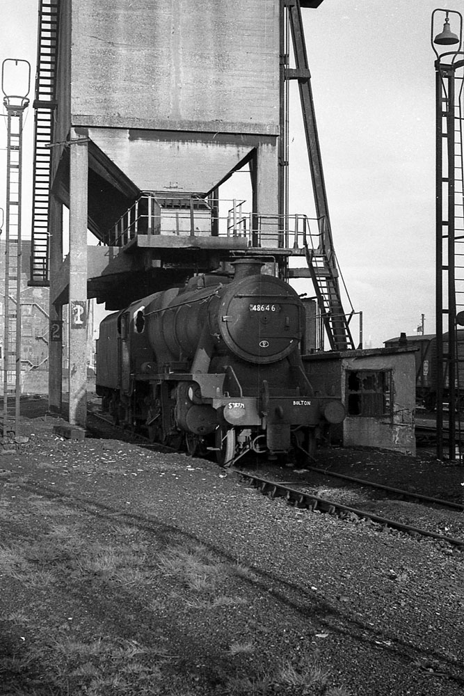 Taken three months after the end of steam. 48646 waits at Bolton for a tow to the scrapyard.