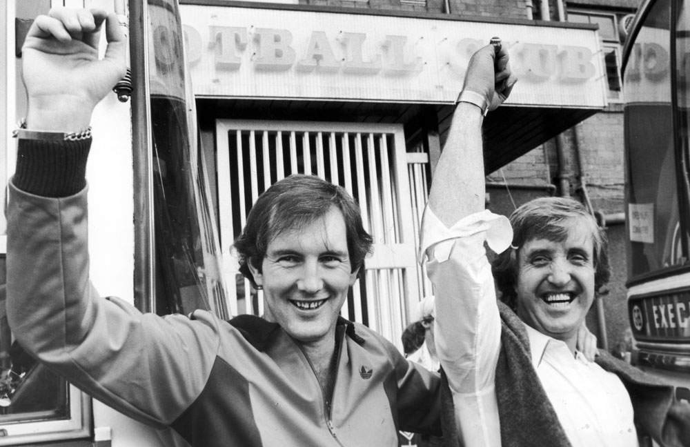 Joe Corrigan and manager John Bond arrive back in Manchester following City's 1981 FA Cup replay defeat by Spurs.