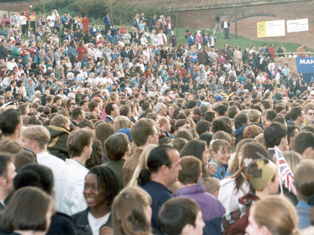 Crowds gather in Castlefield to hear the Olympic games' decision