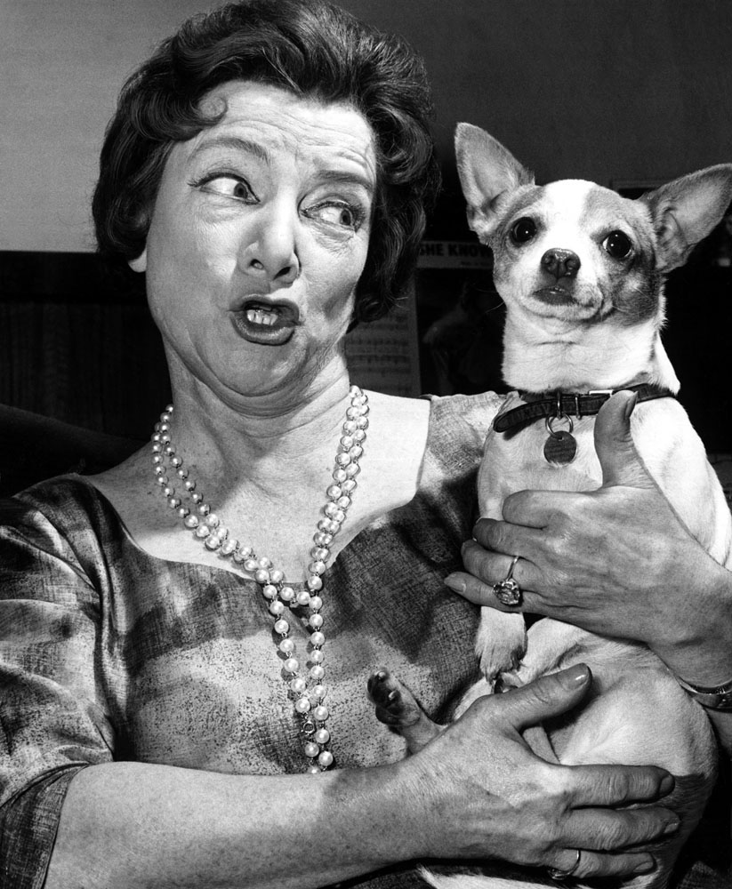 Nearest and Dearest actress Hylda Baker with her pet dog, June 1963