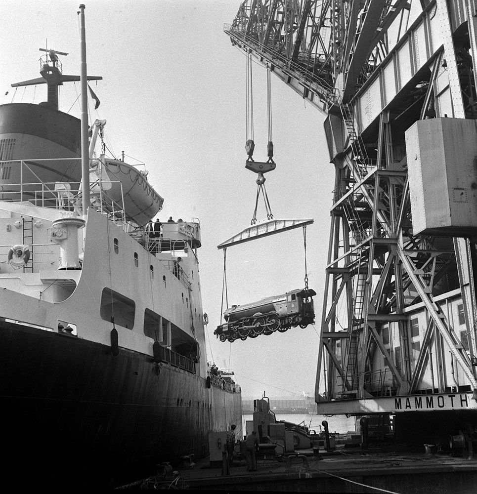Floating crane Mammoth loads the Flying Scotsman on to the Cunard freighter Saxonia at the Mersey Docks, September 1969