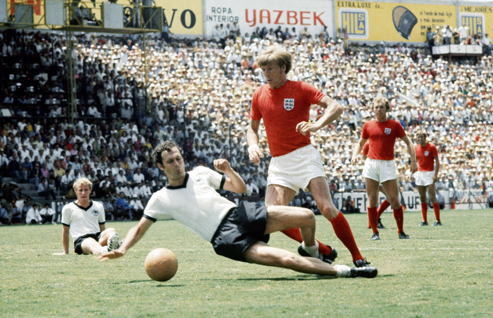 Franz Beckenbauer tackles Colin Bell in the 1970 World Cup quarter final