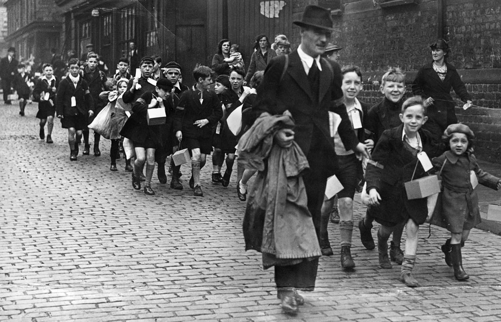 Evacuees walk to the rail station to leave Liverpool at the start of World War II, September 1939