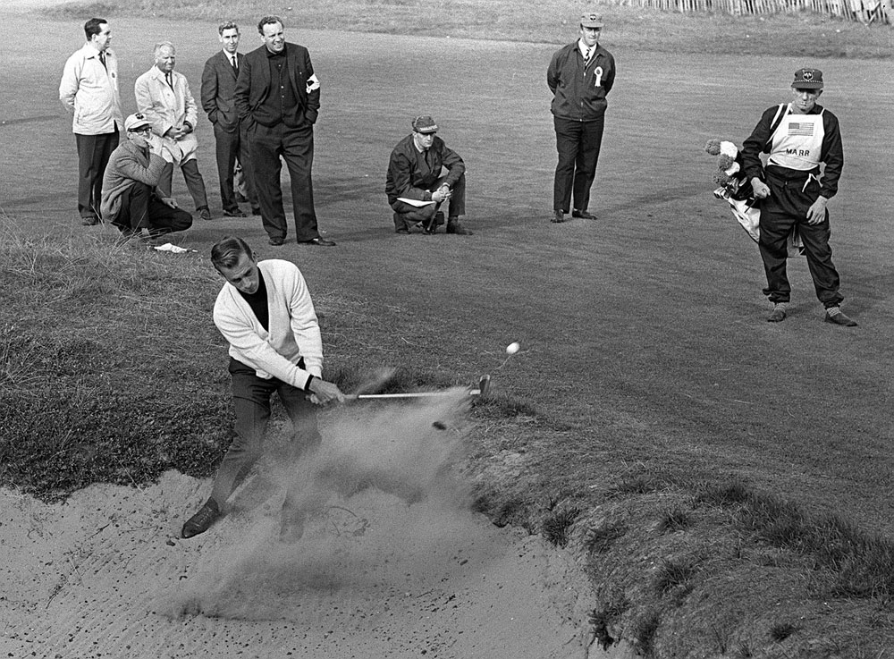 American legend Arnold Palmer fires a shot from the bunker in the 1965 Ryder Cup at Royal Birkdale