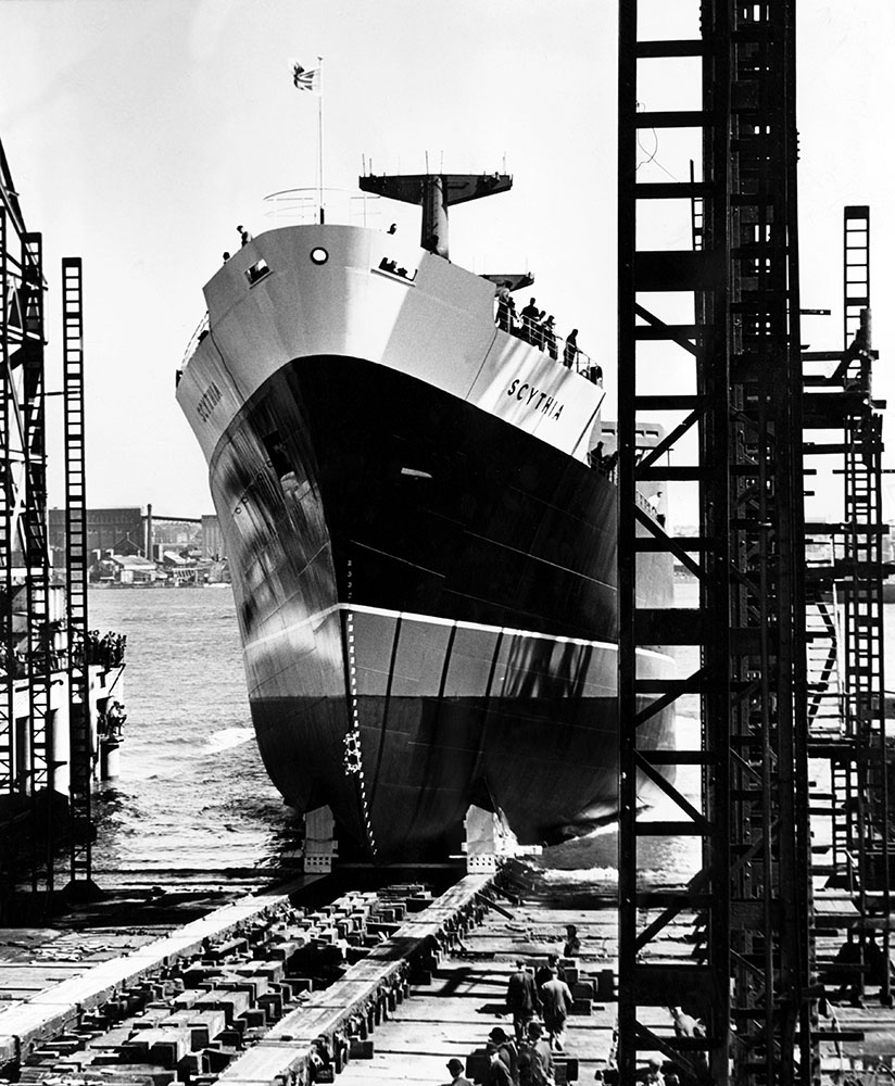 Freighter Scythia glides down the slipway at Cammell Laird's shipyard, August 1964