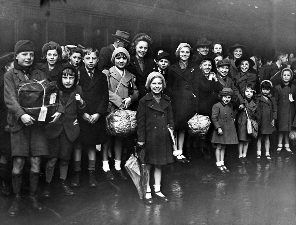 Smiles all round at Lime Street station as evacuees return from Wales, November 1944