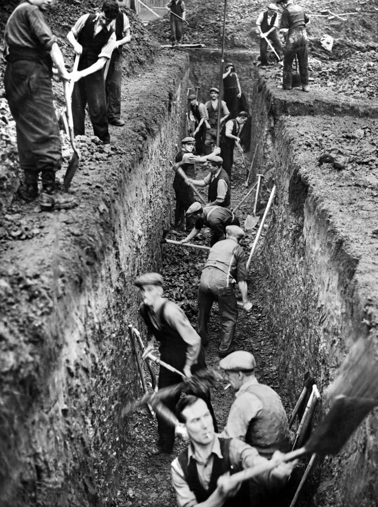 Workers dig trenches to build shelters in Birkenhead Park, September 1938