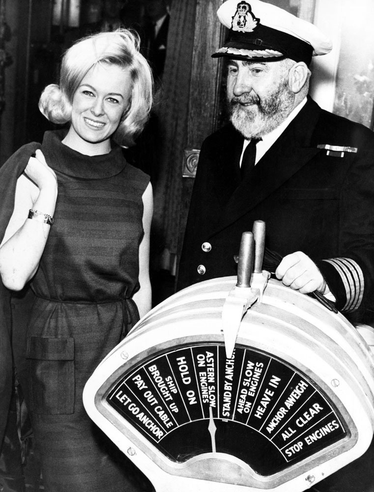 QE2 master Commodore William E. Warwick aboard the Carinthia with Miss Liverpool Maureen Martin, December 1966
