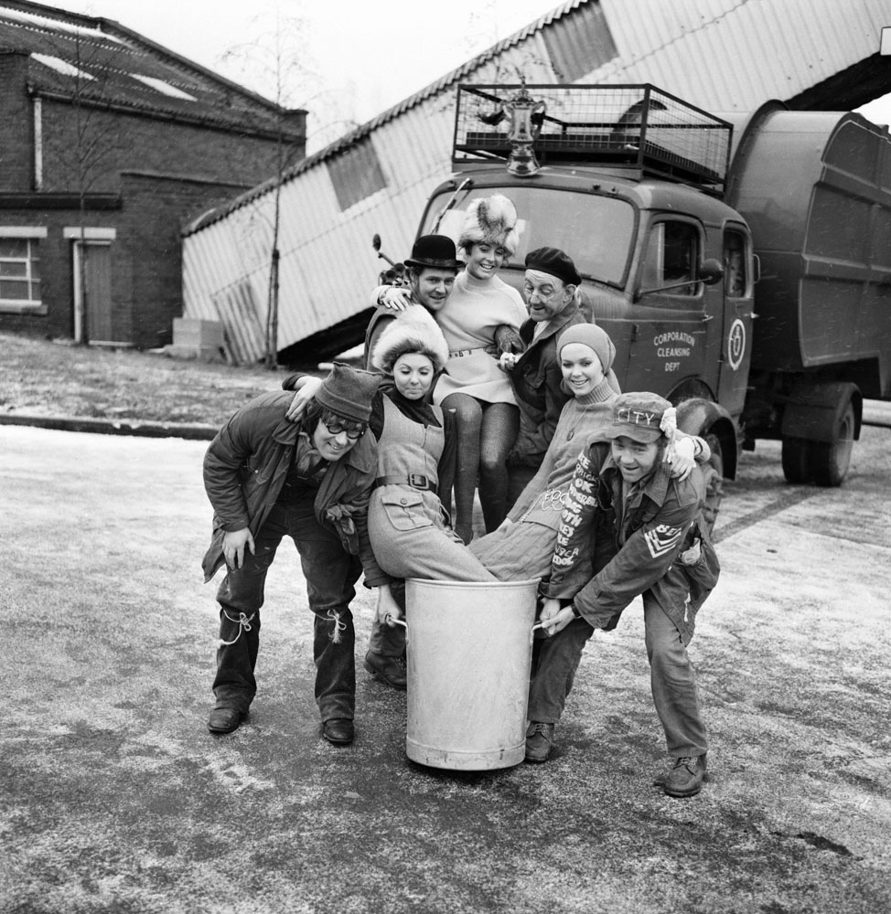Stars from The Dustbinmen in a charity photo-shoot, December 1969